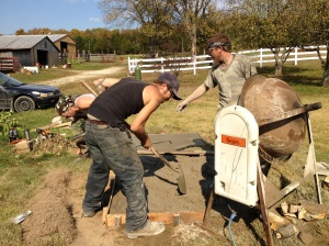 Dave and Greg pouring the pad using the concrete mixer from the farm.