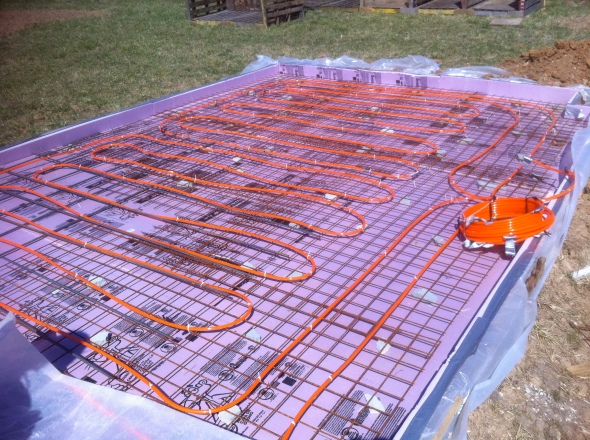 Here's the pex laid in the greenhouse. Hot water from the boiler will pass through these lines to heat the concrete and ultimately the greenhouse.