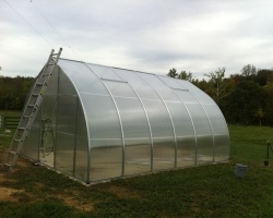 the finished Riga kit greenhouse with radiant heated floor powered by our wood boiler