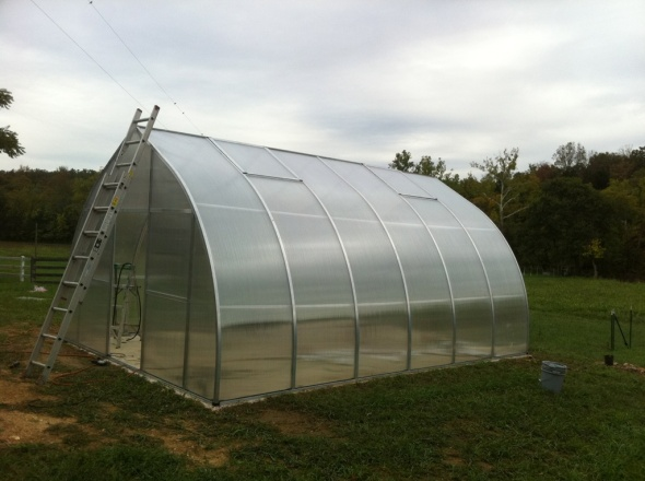 The finished greenhouse!!! TA-DAAAA! An awesome greenhouse with radiant heat floor powered by our wood boiler.