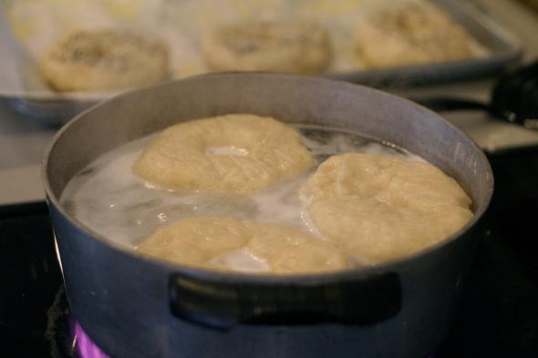 Boiling bagels for homemade bagels.
