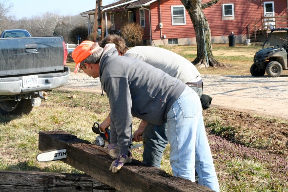 cutting railroad ties with chainsaw