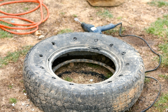Step Three: Drill holes in tire for drainage.