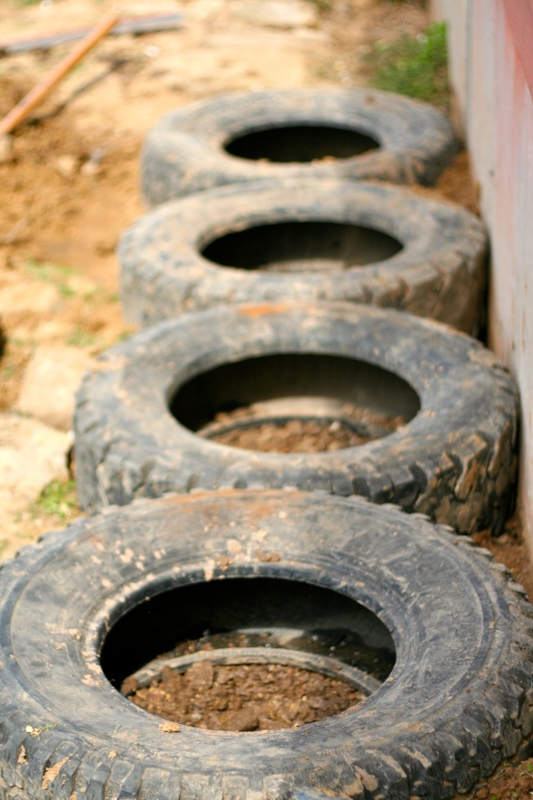 Step Five: Set the tires in place. Add rocks or more gravel in, around and under each tire to get them all even and level with each other