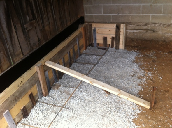Here's the forms we built for the back wall. We also started to lay down the gravel bed, so we'll have a nice level slab.
