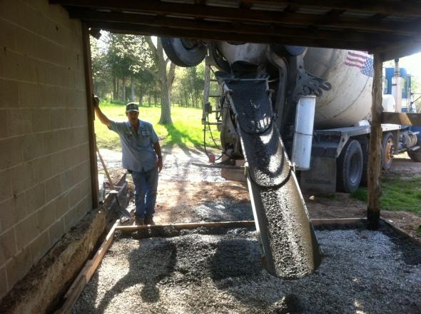 Concrete truck driver worke'n hard.