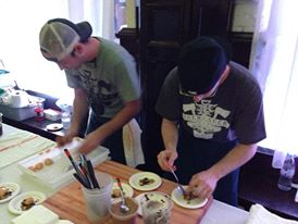 "Chef Josh and Chef Kevin serving up our pumpkin and bok choy at Slow Food STL's ""Art of Food"" event. Check out those sweet shirts they're wearing!"